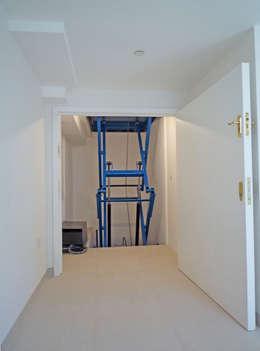 Garages/schuren door Paul Wiggins Architects