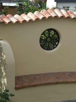Giardino in stile in stile Rustico di Rimini Baustoffe GmbH