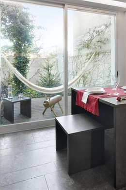 Casa Sofia Passarinho: Sala de jantar  por Valchromat
