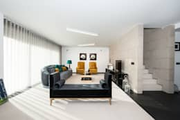minimalistic Living room by mioconcept