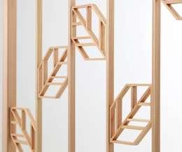 オリジナルモダン組子「リーフ」: 有限会社種村建具木工所が手掛けた窓です。