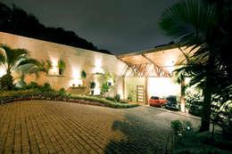 Projekty, rustykalne Domy zaprojektowane przez Central de Projetos