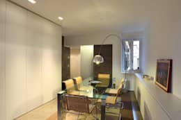 casa di ringhiera: Sala da pranzo in stile in stile Minimalista di studio ferlazzo natoli