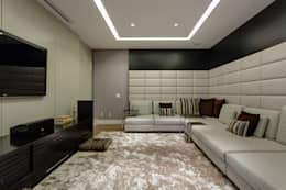 Home Theater: Salas multimídia modernas por Isabella Magalhães Arquitetura & Interiores