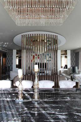 Livings de estilo moderno por Orkun İndere Interiors