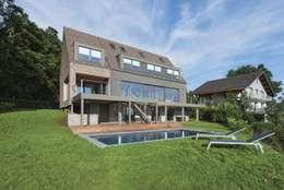 Projekty, nowoczesne Domy zaprojektowane przez BURO5 - architectes & associés