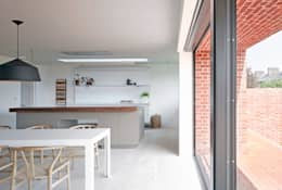 ​View of the kitchen from the dining area at the house at Broad Street in Suffolk: modern Kitchen by Nash Baker Architects Ltd