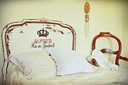 Camas: Dormitorios de estilo rural por Capítulo Dos
