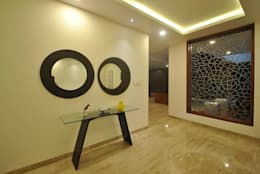 Mr & Mrs Pannerselvam's Residence:  Walls by  Murali architects