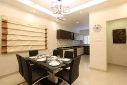 Model Flat: modern Dining room by Design Cafe