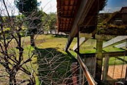 Projekty, rustykalne Domy zaprojektowane przez Quinta