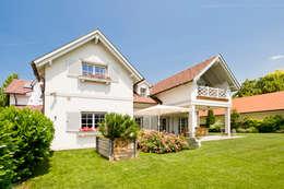 Projekty, śródziemnomorskie Domy zaprojektowane przez WUNSCHHAUS