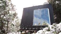 Alpina#1: Casas de estilo moderno por forma