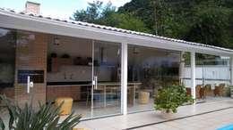 Garajes y galpones de estilo  por Thaiad Pinna -Studio de Arquitetura e Interiores