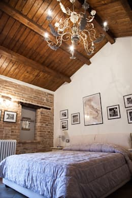 10 spettacolari camere da letto con muro in pietra for Tre case di pietra