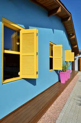 Casas de estilo topical por Arquitetando ideias