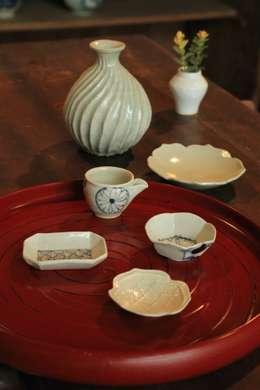 小人の器で宴: 吉田崇昭が手掛けたキッチンです。