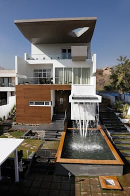 Cantilever House: modern Houses by NA ARCHITECTS