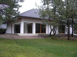 Nowoczesny dom LIV 3 G2 - przytulnie i pięknie!: styl nowoczesne, w kategorii Domy zaprojektowany przez Pracownia Projektowa ARCHIPELAG