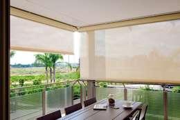 Projekty, nowoczesne Okna i drzwi zaprojektowane przez Emporio del Tessuto