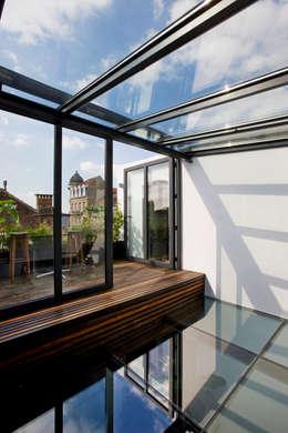 Coeur de verre: Terrasse de style  par VORTEX atelier d'architecture