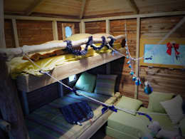 Une cabane a Aix en Provence: Chambre d'enfant de style de style Méditerranéen par Cabaneo