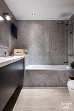 Banheiros minimalistas por Dröm Living
