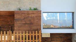 Casas de estilo rústico por R. Borja Alvarez. Arquitecto