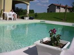 Projet maison avec piscine Lentilly: Piscines  de style  par Concept Creation