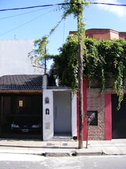 Casas de estilo moderno por PERSPECTIVA