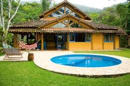 Casas de estilo rústico por MADUEÑO ARQUITETURA & ENGENHARIA