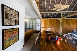 tropical Dining room by Antônio Ferreira Junior e Mário Celso Bernardes