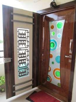 Mr.M Residential Flat:  Windows by DESIGNER GALAXY