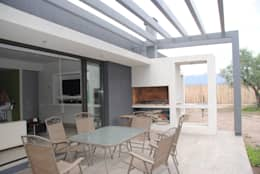 Jardines de estilo ecléctico por Bonomo&Crespo Arquitectura