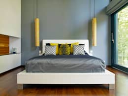 modern Bedroom by Baufritz (UK) Ltd.