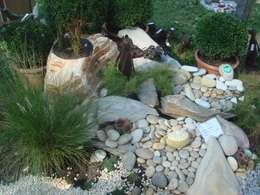 Jardines de estilo clásico por MM NATURSTEIN GMBH