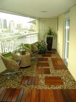 Terrace by MC3 Arquitetura . Paisagismo . Interiores