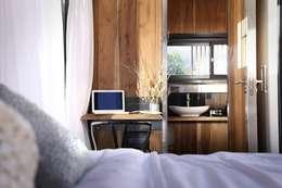 Proyecto Nomad: Dormitorios de estilo moderno por T + T Arquitectos