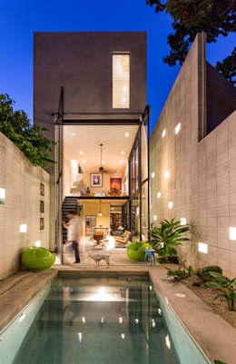 Projekty, eklektyczne Domy zaprojektowane przez Taller Estilo Arquitectura