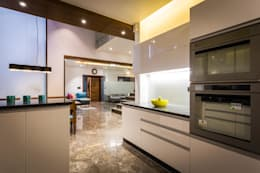 Chandresh bhai interiors: modern Kitchen by Vipul Patel Architects
