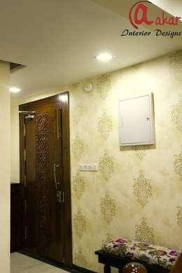 Mr. Chandak's Duplex Apartment:  Walls by ES Designs