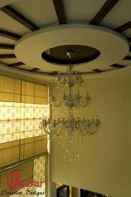 Mr. Chandak's Duplex Apartment:  Corridor & hallway by ES Designs