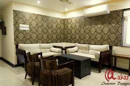 Mr. Chandak's Duplex Apartment: modern Living room by ES Designs