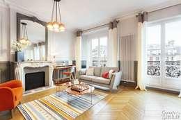 Grand salon avec parquet: Salon de style de style Moderne par Carnets Libellule