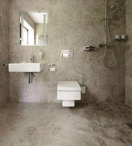 Baños de estilo moderno por Floors of Stone Ltd