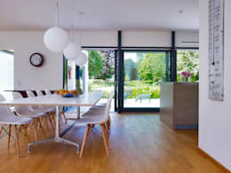 modern Dining room by Baufritz (UK) Ltd.