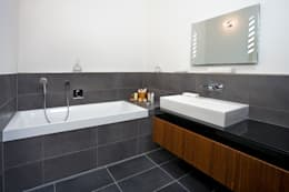 modern Bathroom by Baufritz (UK) Ltd.