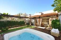 Projekty, rustykalne Spa zaprojektowane przez Stefani Arquitetura