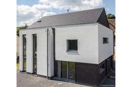 DELTA Architects Belgique: modern tarz Evler