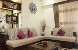 Mr.Pramod Chaudhary at Cosmos Horrizon: modern Living room by UNIQUE DESIGNERS & ARCHITECTS